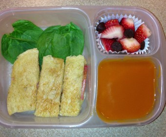 Tomato soup with grilled shrimp, grilled cheese with tomatoes on a bed of baby spinach and strawberries with a few chocolate chips. All ingredients organic.