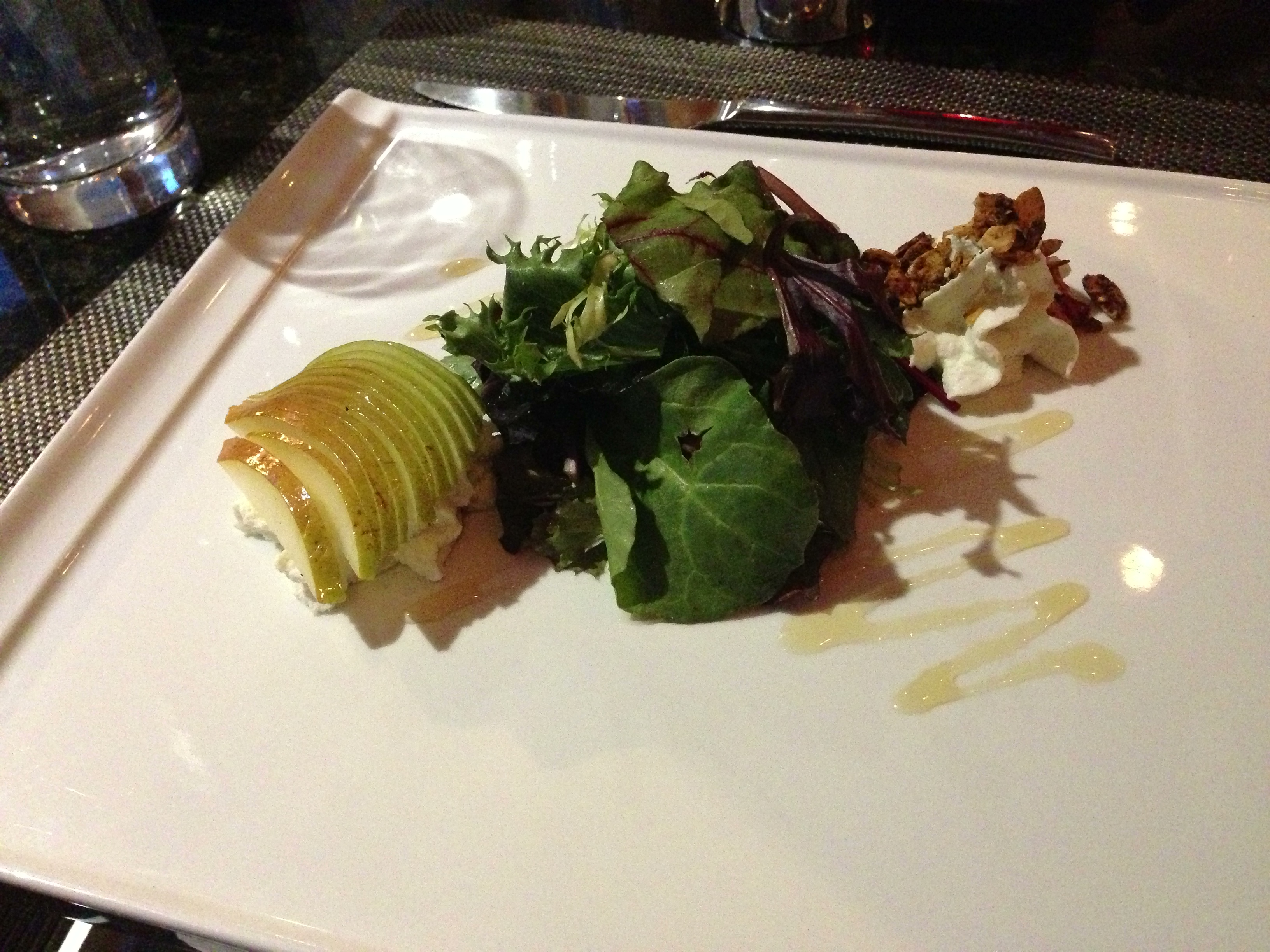 Pear salad: whipped goat cheese, toasted almonds, mixed green, mead vinaigrette, honey drizzle.