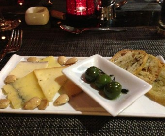 Assortment of local cheese that I can't remember for the life of me. With warm castelvetrano olives and ciabatta toast.