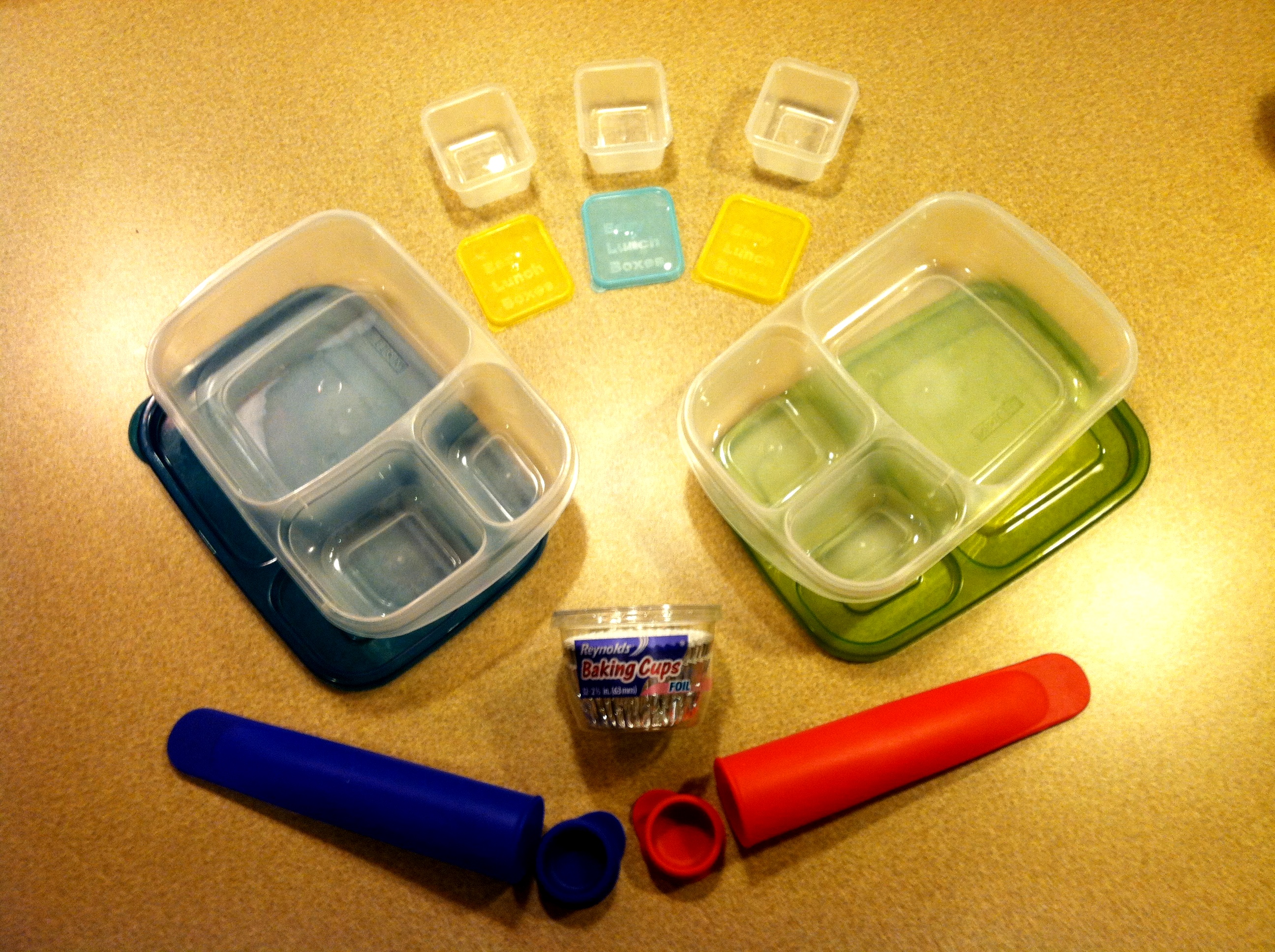 All these items can be found at Amazon.com or EasyLunchBoxes.com. The blue and red cones are silicone tubes with screw caps. We fill them with smoothies, freeze them overnight, and by lunch time, it has thawed out enough to squeeze and enjoy.
