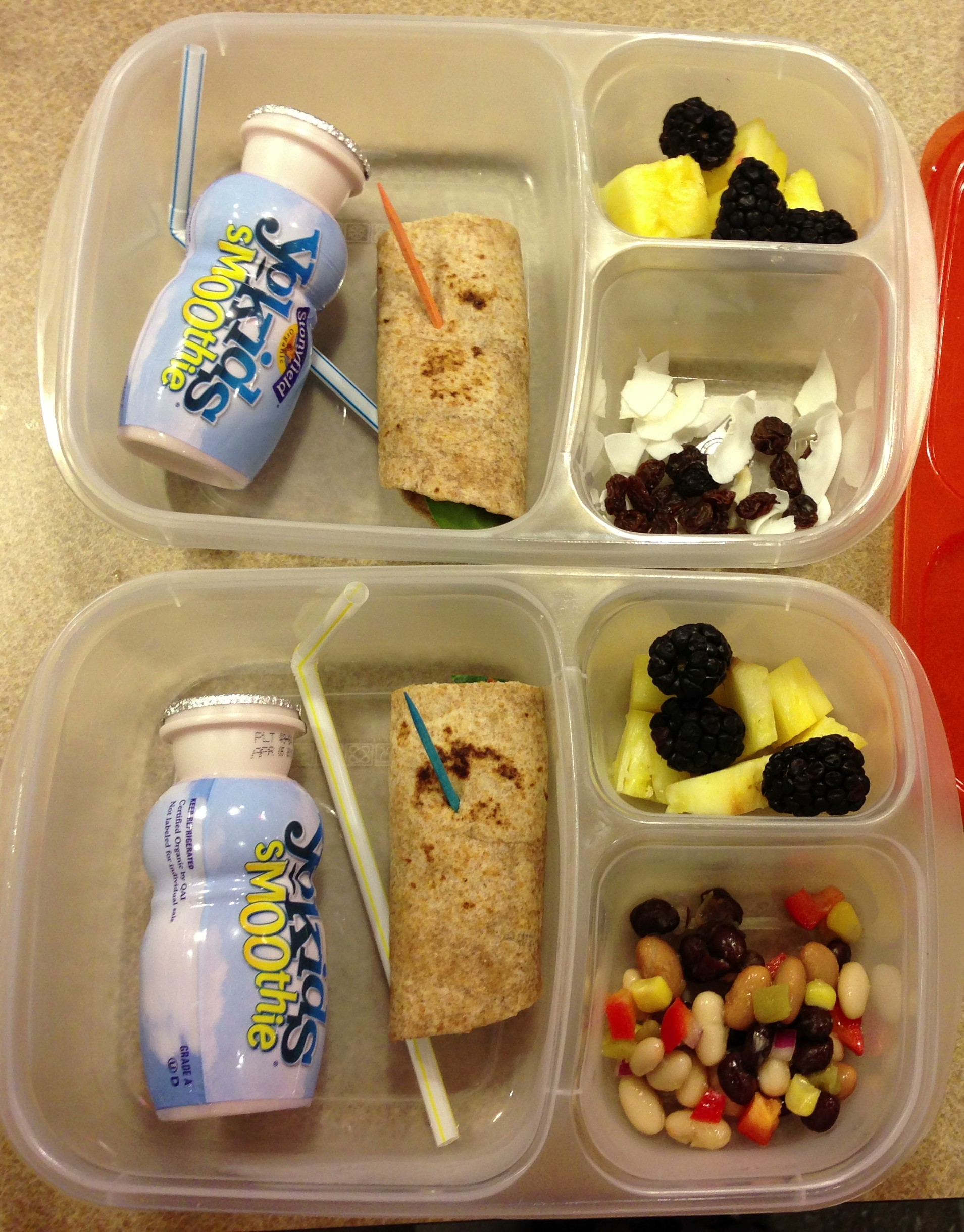 Today's lunch: Hummus, spinach, cheese and tomato in a whole wheat wrap, pineapple and blackberries, Laynie has texas caviar and Liam has raisins and coconut flakes, yogurt smoothie for a treat
